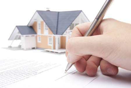 signing a loan mortgage form