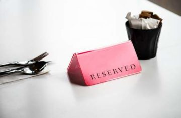 reserved table sign with a drink